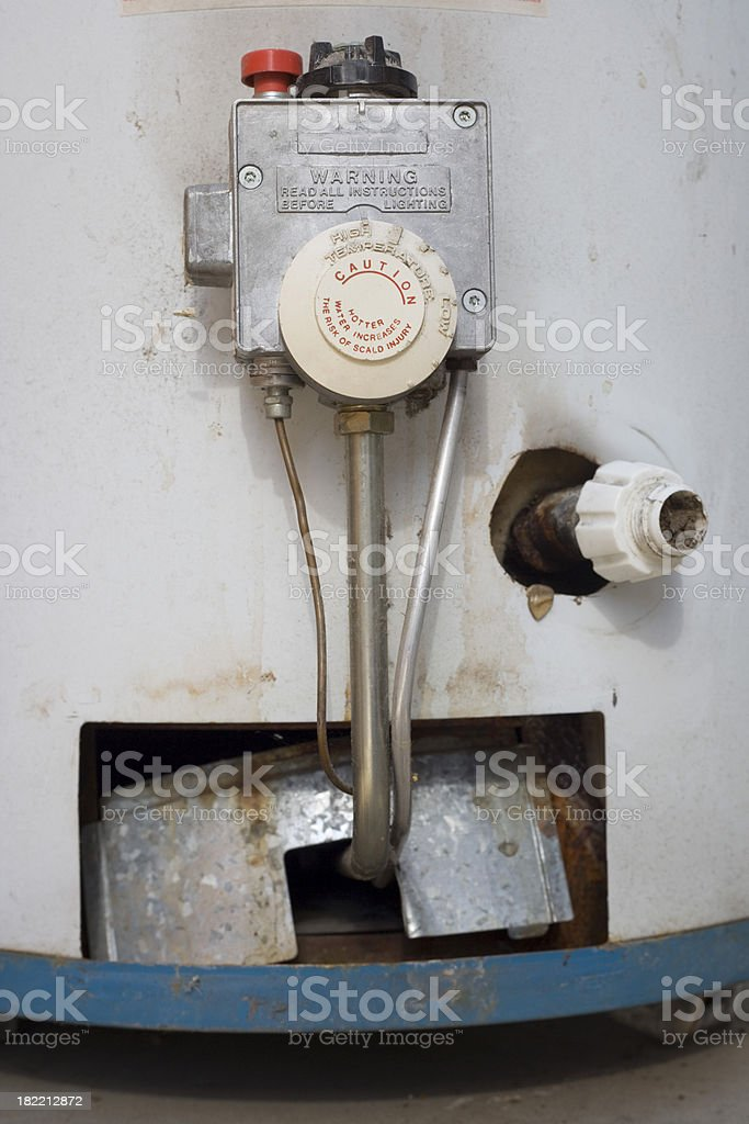 Water heater on wheels with rust and dirt spots royalty-free stock photo