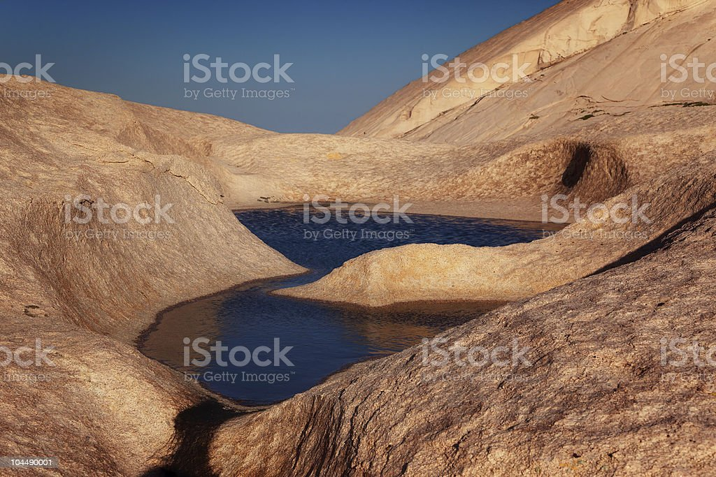 Water in desert mountains stock photo