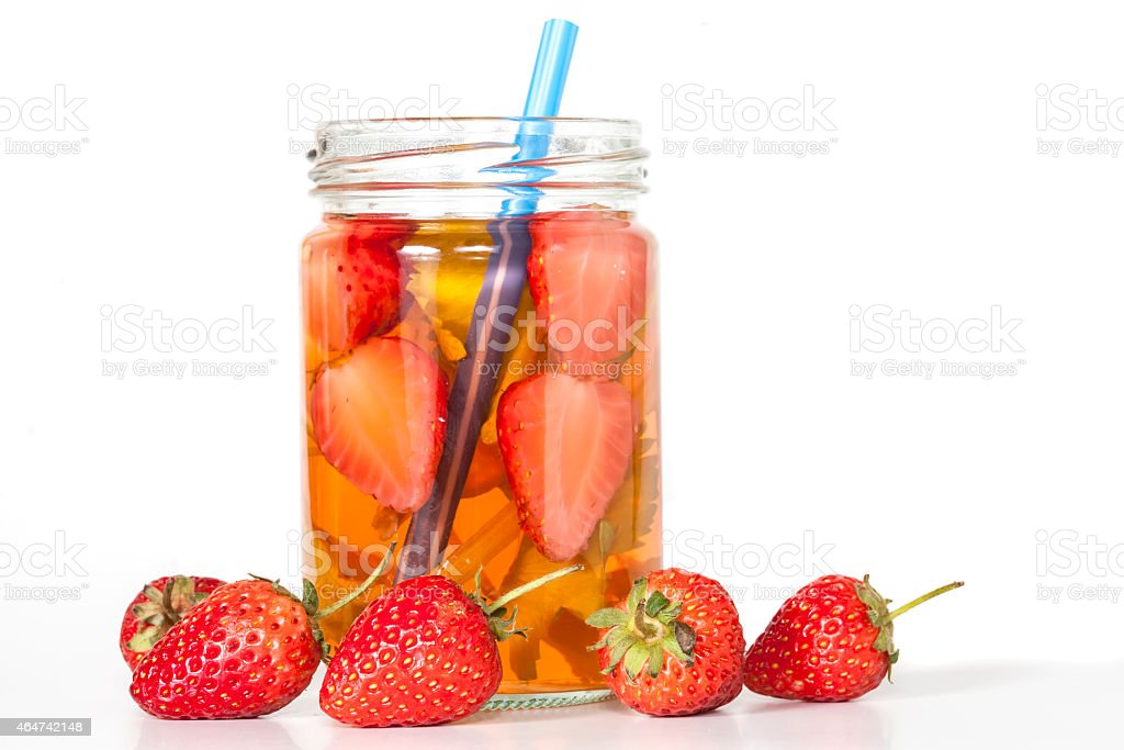 Water infused by strawberries on a glass pot stock photo