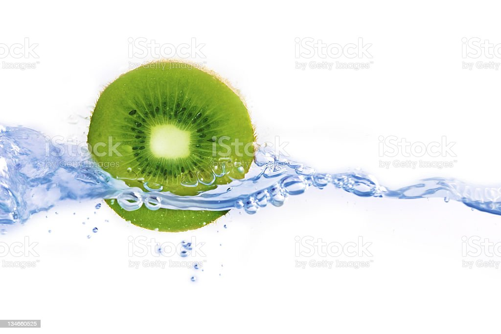 Water jet around kiwi on white background royalty-free stock photo