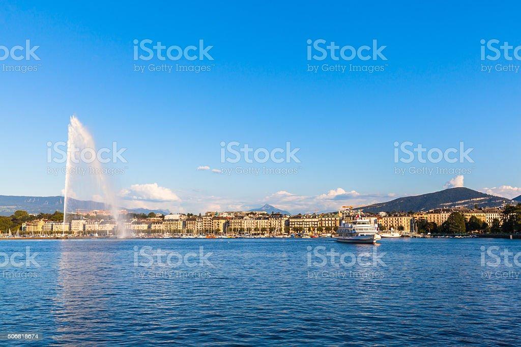 Water jet fountain at sunset in Geneva stock photo