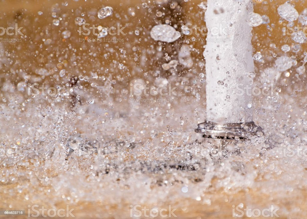 Water jet fountain close up stock photo