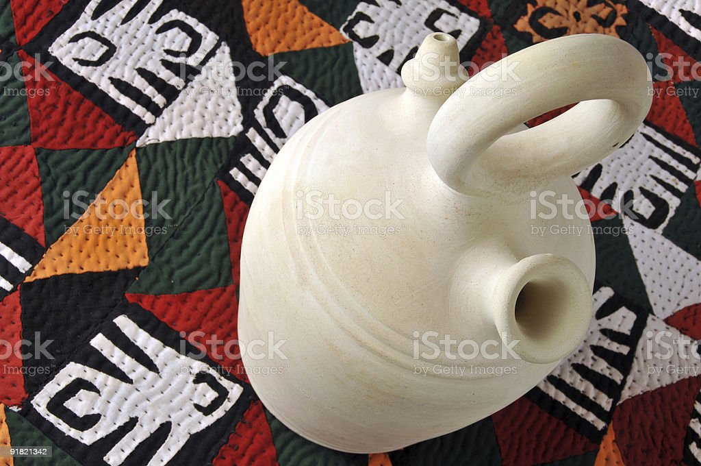 Water jug on quilt royalty-free stock photo
