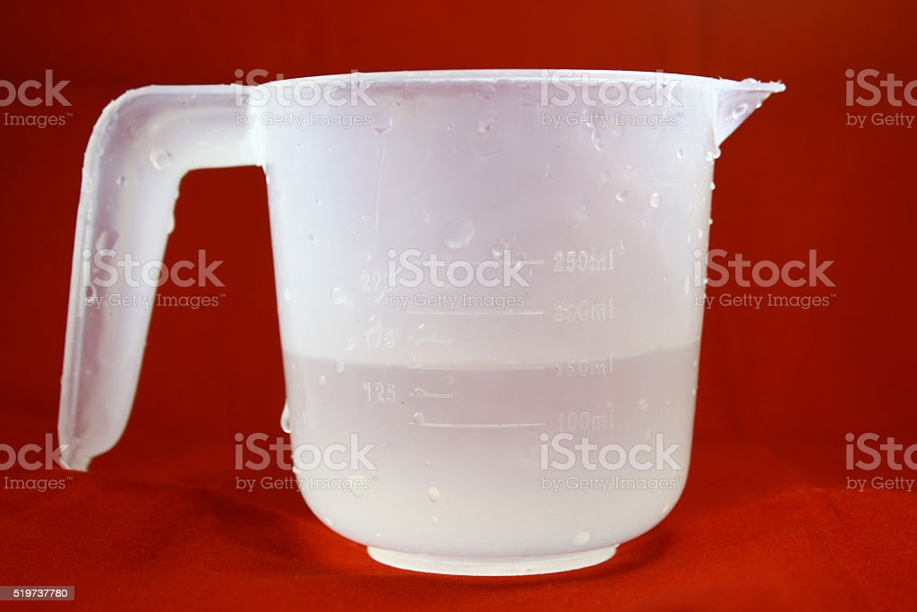 Water jug on red background stock photo