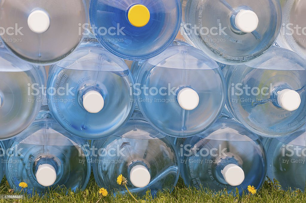 Water Jugs Stacked on Grass stock photo
