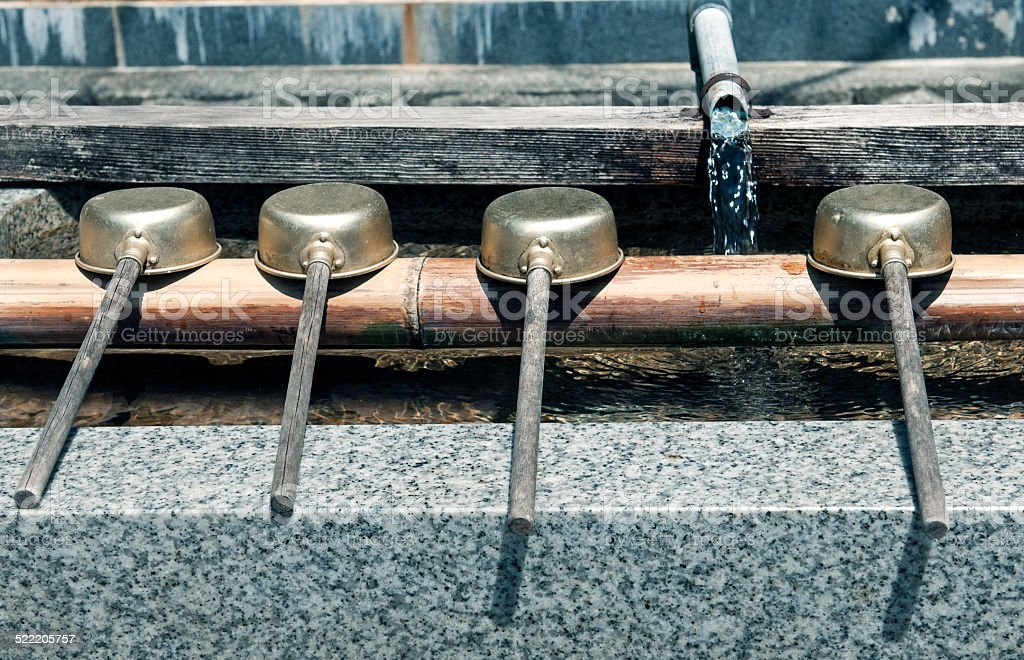 Water ladles at Buddhist cemetery in Japan stock photo