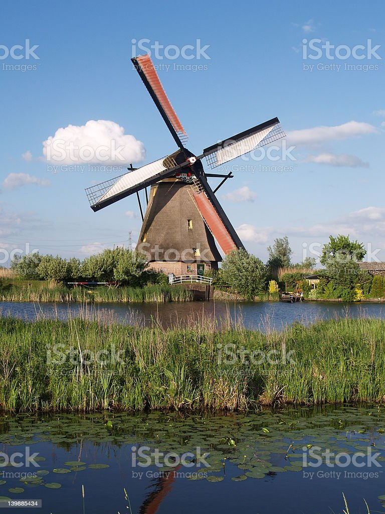 Water land and windmill royalty-free stock photo