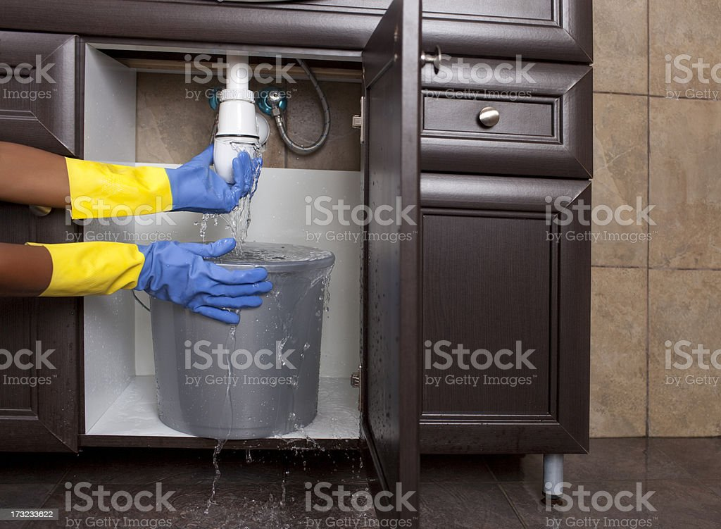 Water leak - flood in the bathroom. stock photo