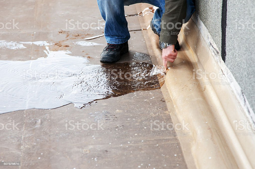 Water leaking from hole stock photo