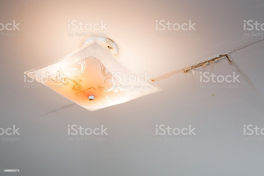 Water leaking from light fixture. stock photo
