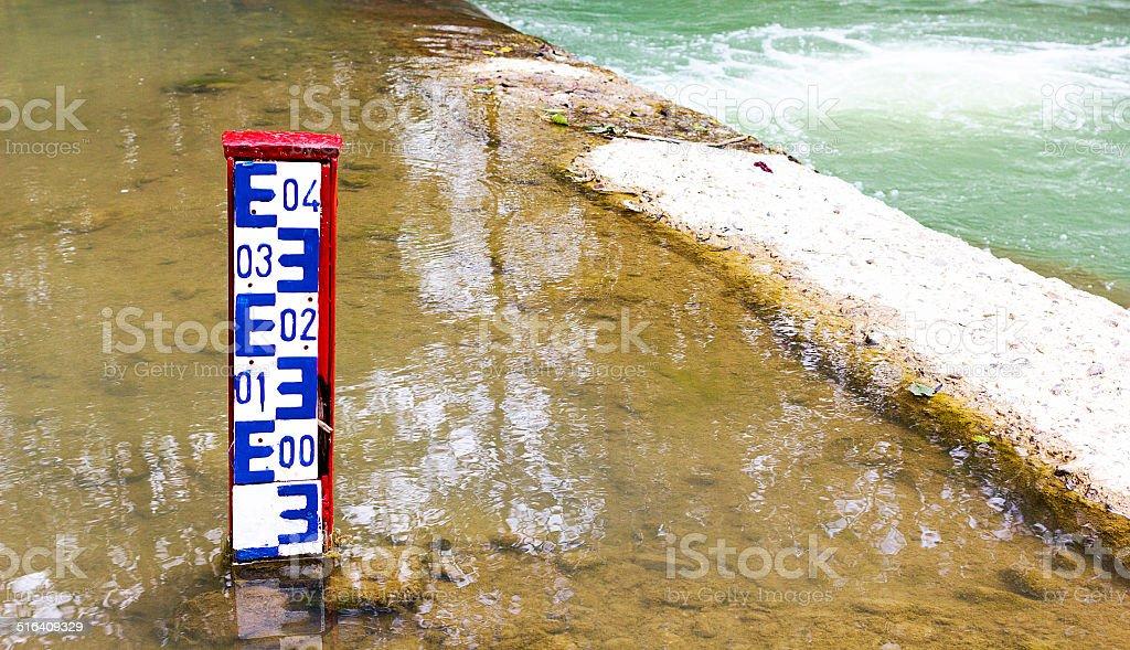 Water level indicator dam stock photo