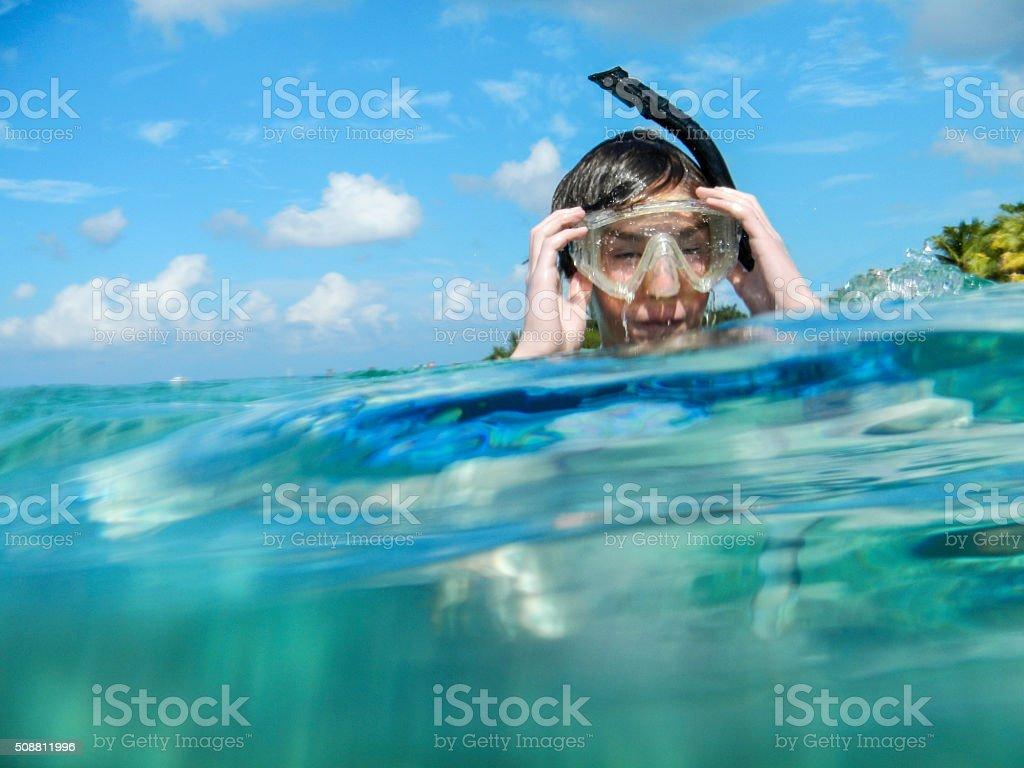 Water logged snorkeler stock photo