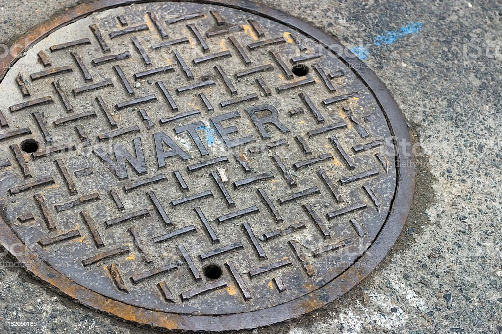 Water Manhole cover stock photo