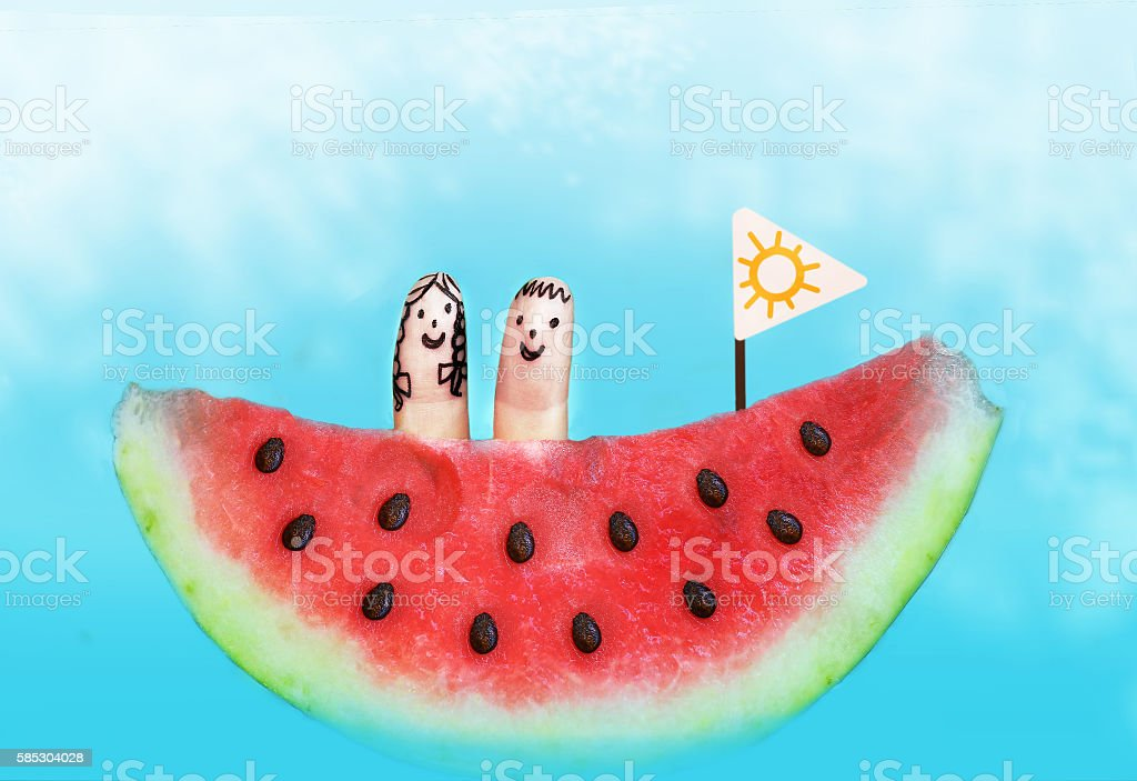 water melon boat with finger kids on board stock photo