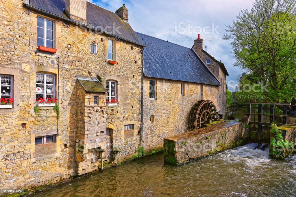 Water mill and Aure River of Bayeux in Normandy France stock photo