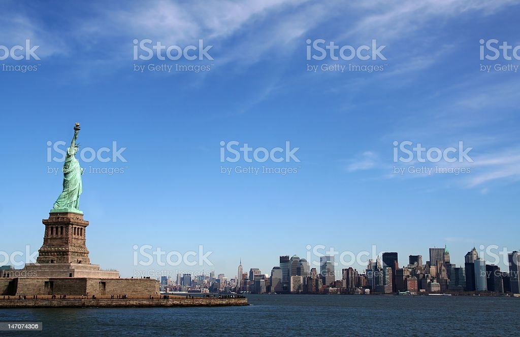 Water next to the statue of Liberty in New York stock photo