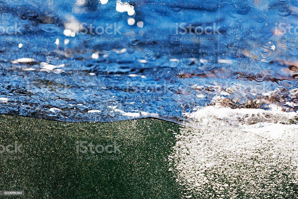 Water ocean wave through a glass window stock photo