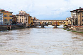 water of Arno river and Ponte Vecchio in autumn
