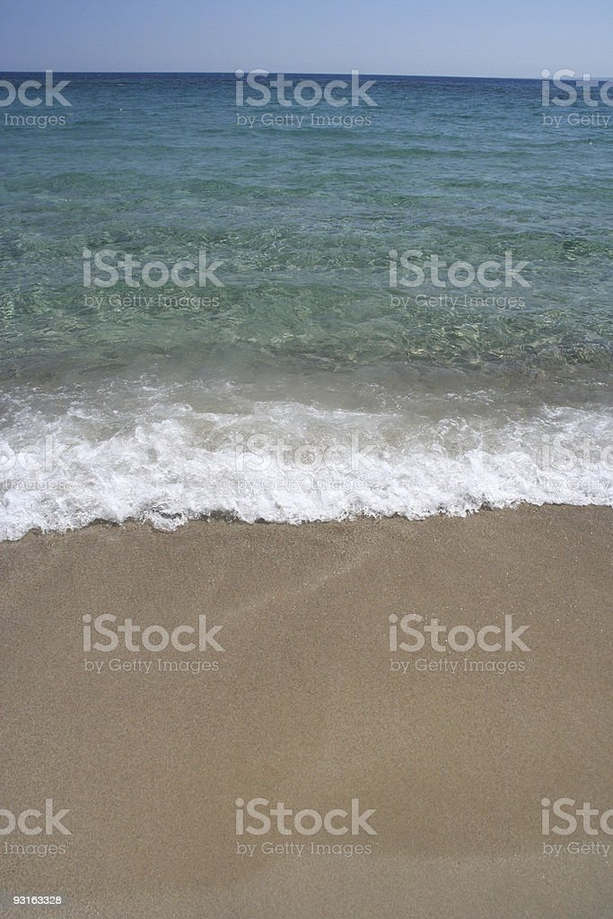 Water on a sandy beach royalty-free stock photo