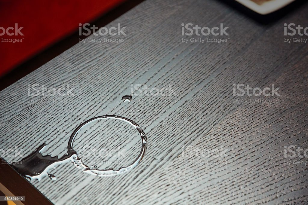 Water on a wooden table stock photo