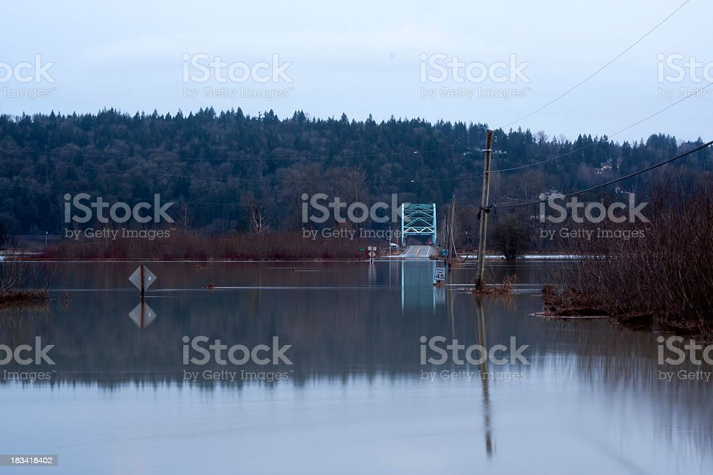 Water Over Roadway - 124th and the Novelty Bridge stock photo