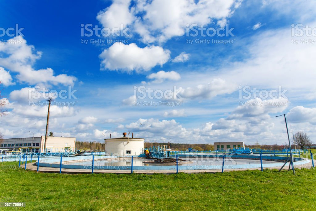 Water overflowing from round settlers stock photo