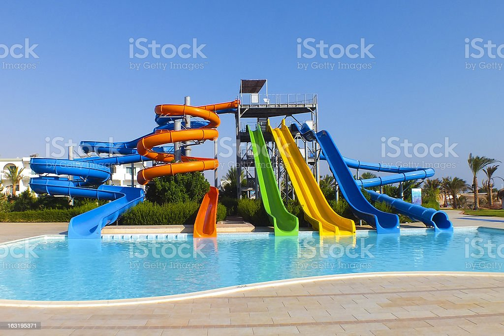 Water park with colorful slides stock photo