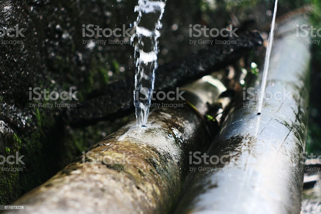Water pipe leaks stock photo