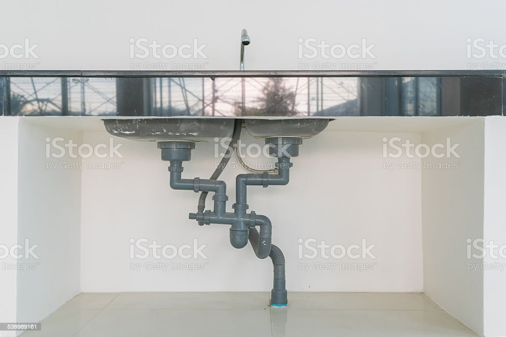 Water pipe under sink stock photo