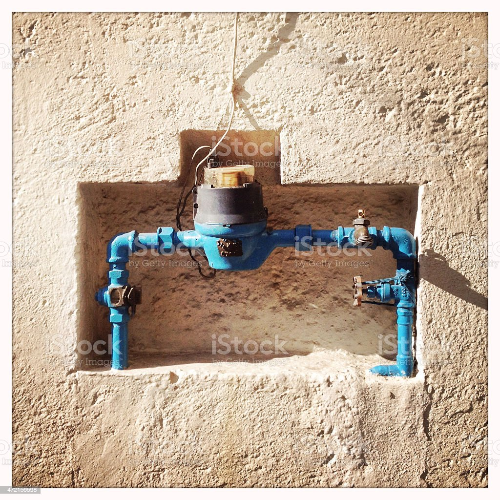 Water pipe with meter outside house stock photo