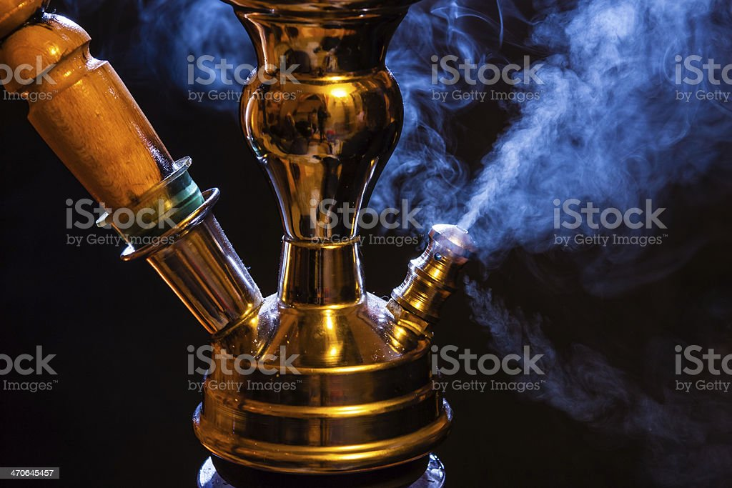 Water pipe with smoke stock photo