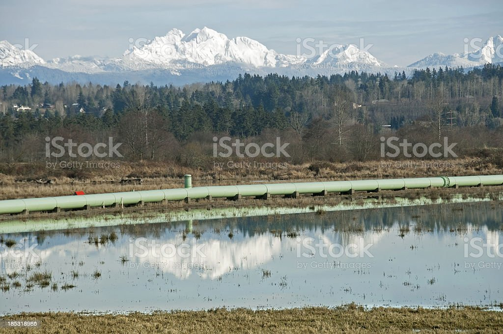 Water pipeline from reservoir supplying city royalty-free stock photo