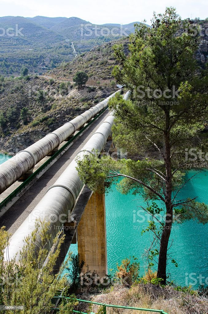 Water pipes in the mountain stock photo