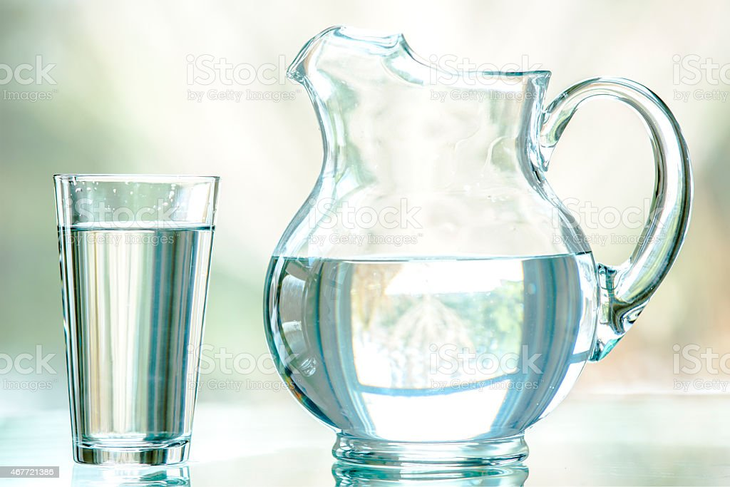 Water Pitcher and Glass stock photo
