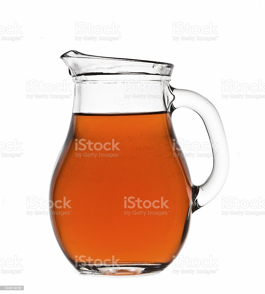 Water pitcher filled with juice royalty-free stock photo