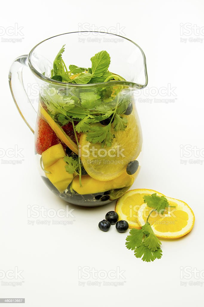 Water pitcher infused with fruit stock photo