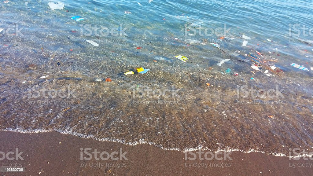 Water pollution at beach stock photo