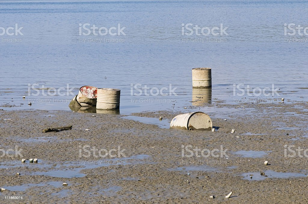 Water pollution - discarded oil drums royalty-free stock photo