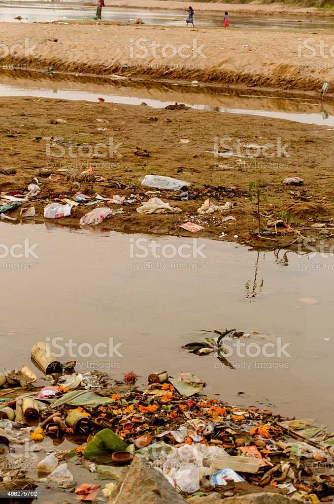 water pollution due to dumping of garbage stock photo