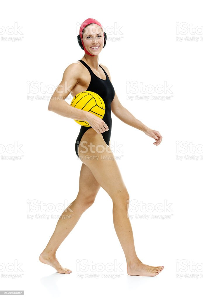 Water polo player walking with ball stock photo