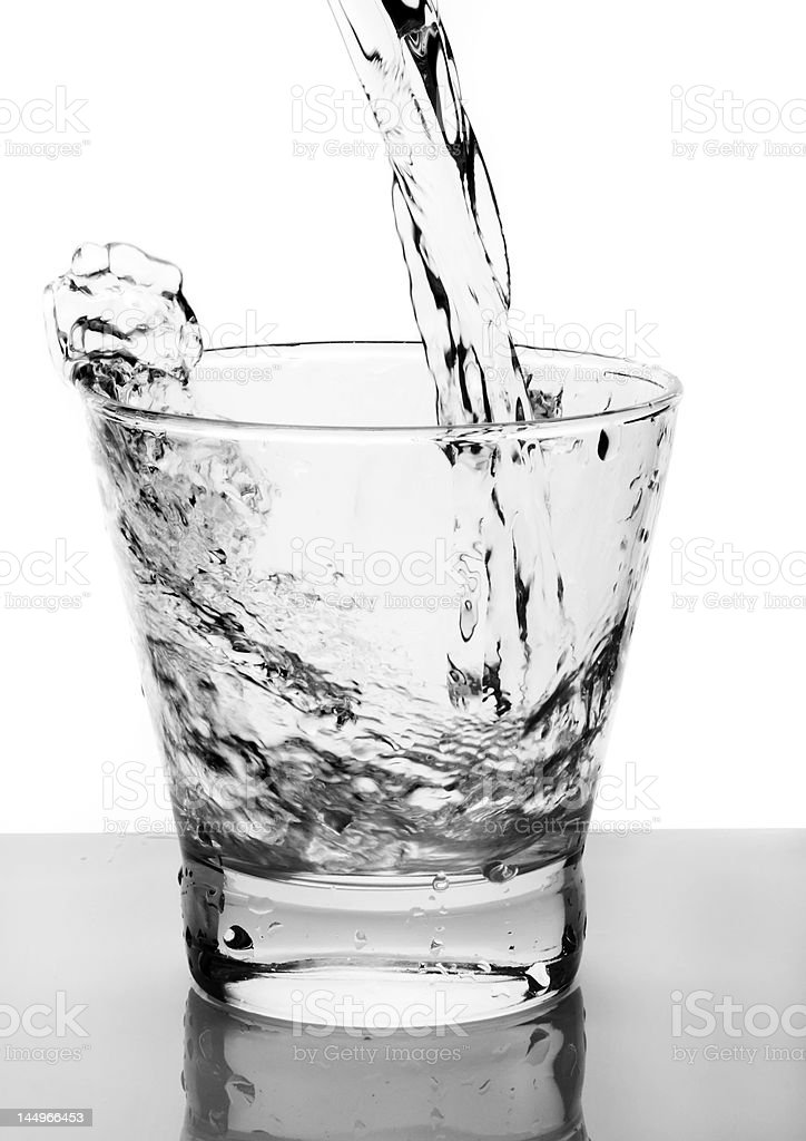 Water poured into glass royalty-free stock photo