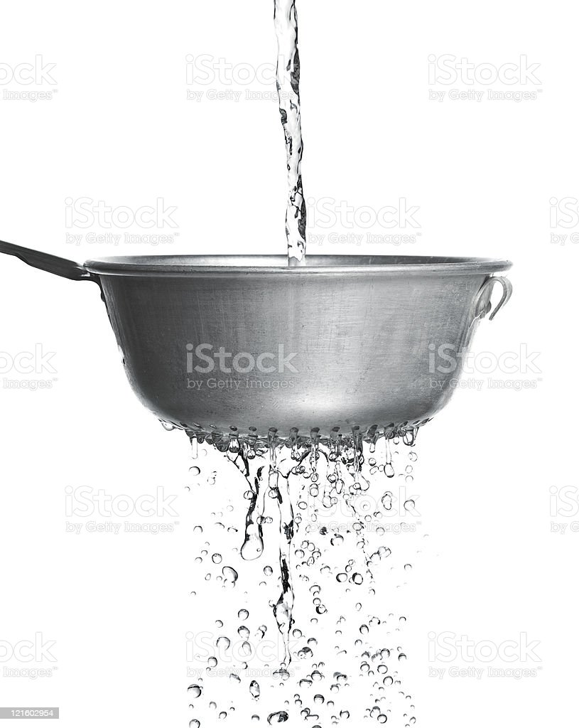 Water poured through a strainer stock photo