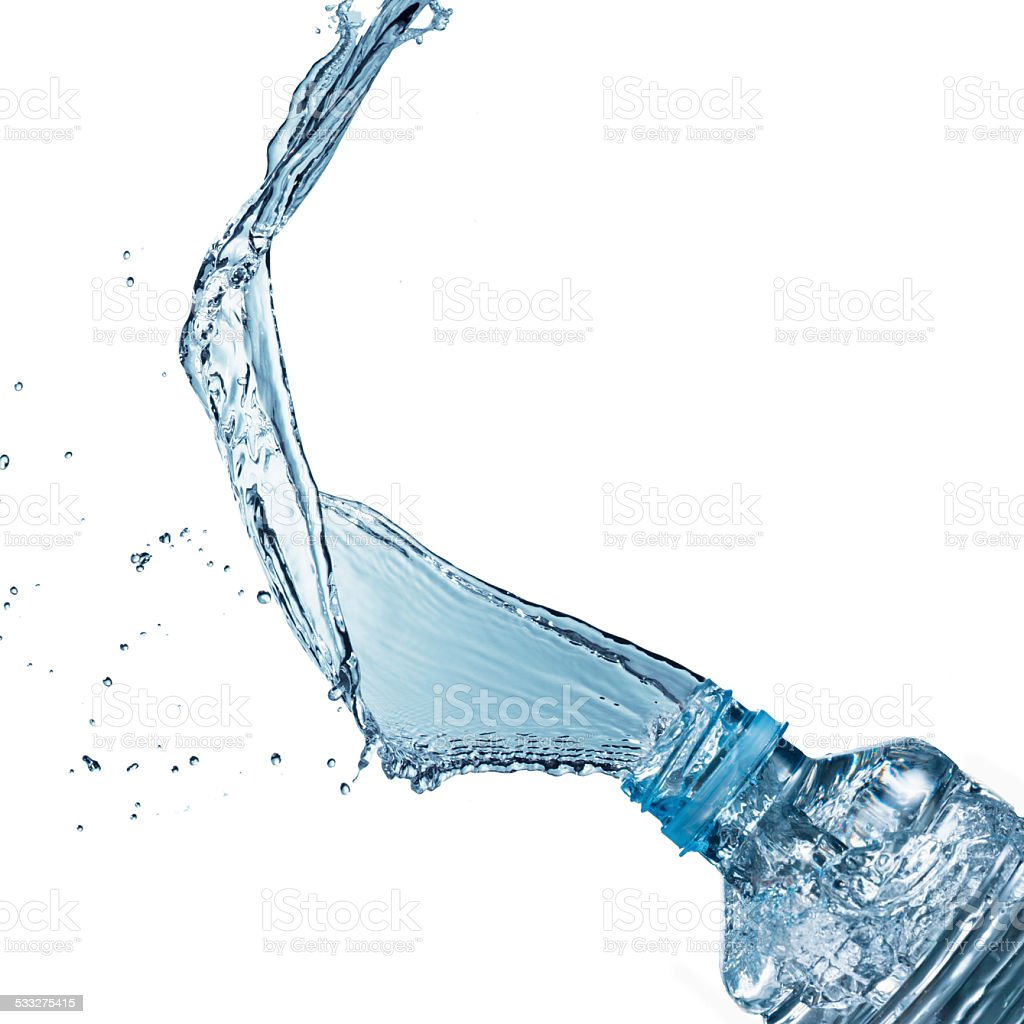 Water pouring from bottle stock photo