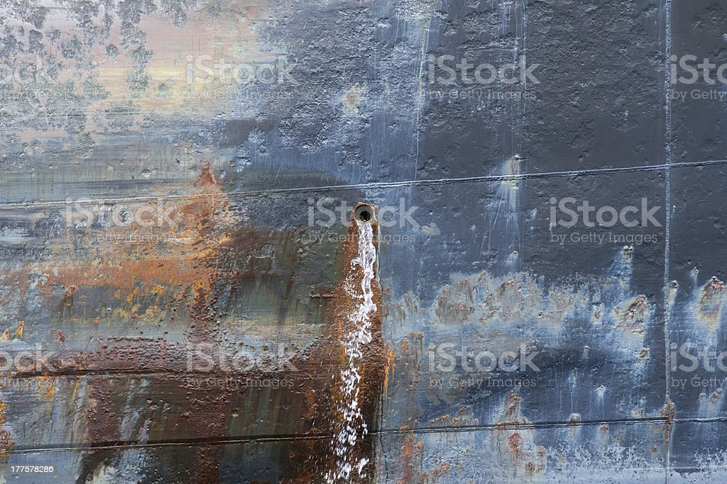 Water Pouring from Iron Ship royalty-free stock photo
