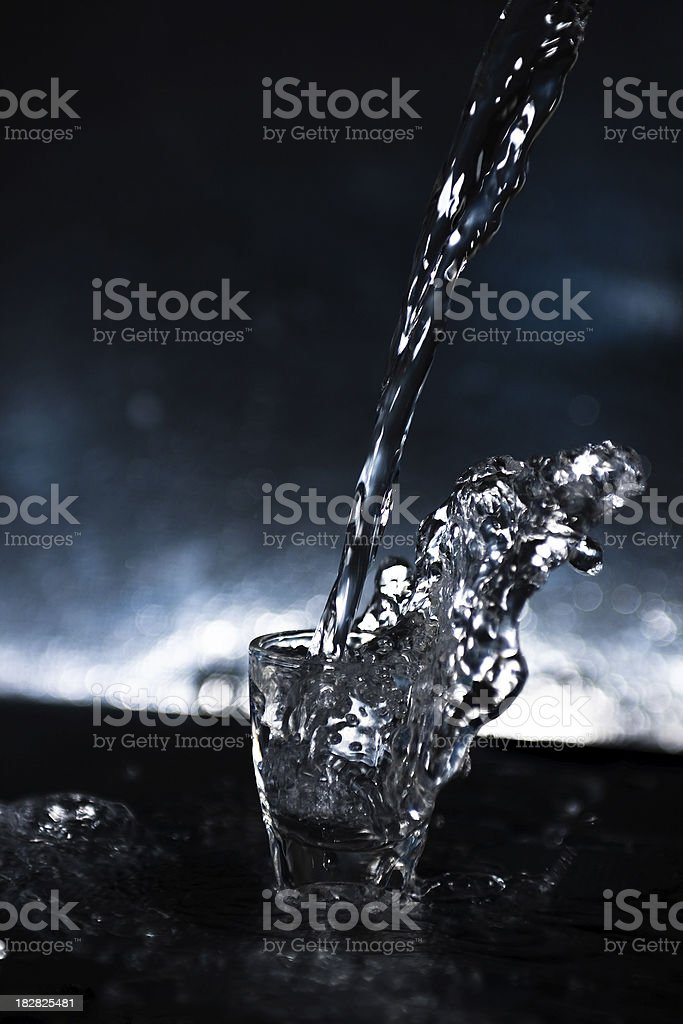 water pouring into cup royalty-free stock photo