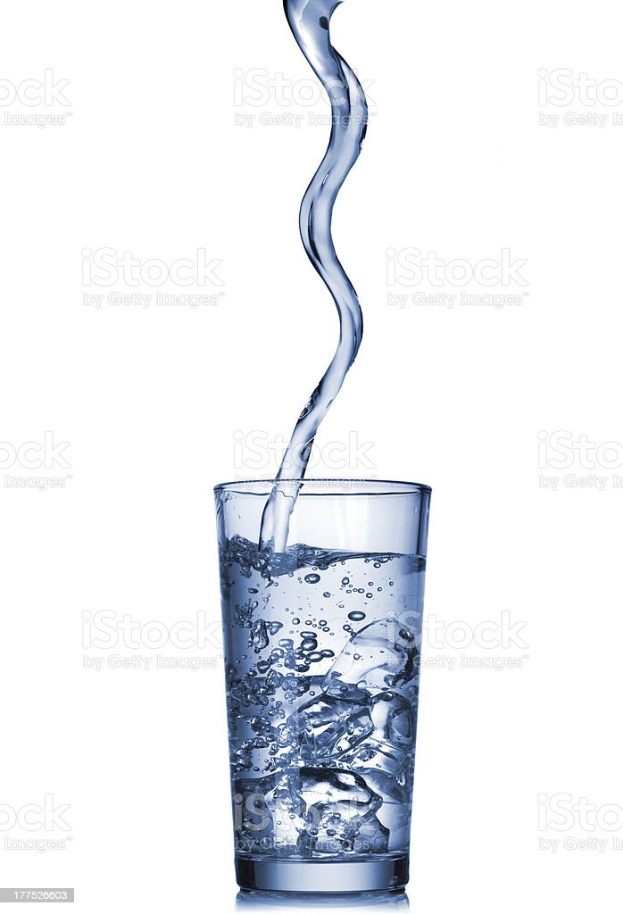 water pouring into glass isolated on white royalty-free stock photo