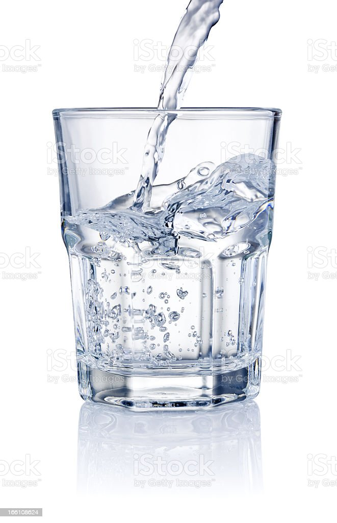 Water pouring into glasses isolated on a white background stock photo