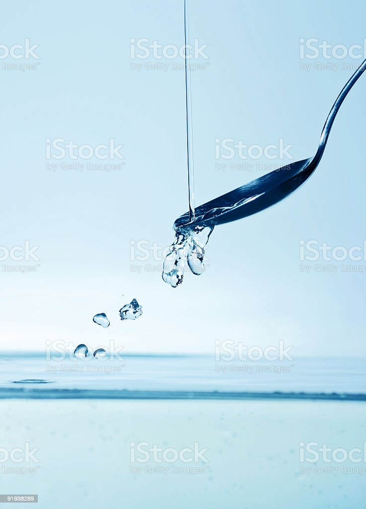 water pouring on spoon royalty-free stock photo