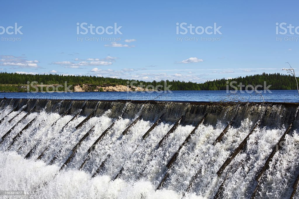 Water pouring over a dam in the daytime royalty-free stock photo