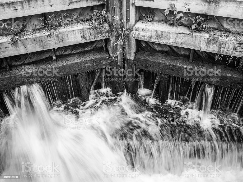 Water Pouring Through Wooden Lock stock photo